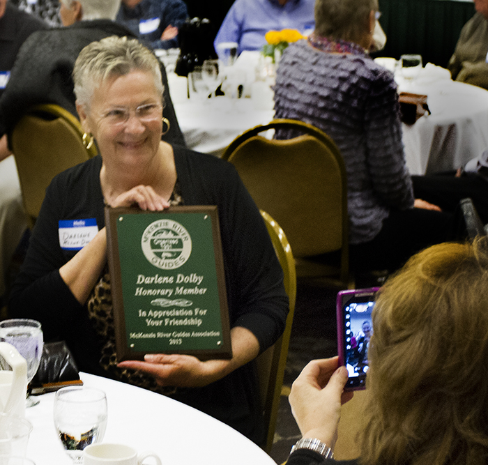 Darlene Dolby showing her honorary membership award at the 2013 Guide's Wives dinner of McKenzie River Guides Association